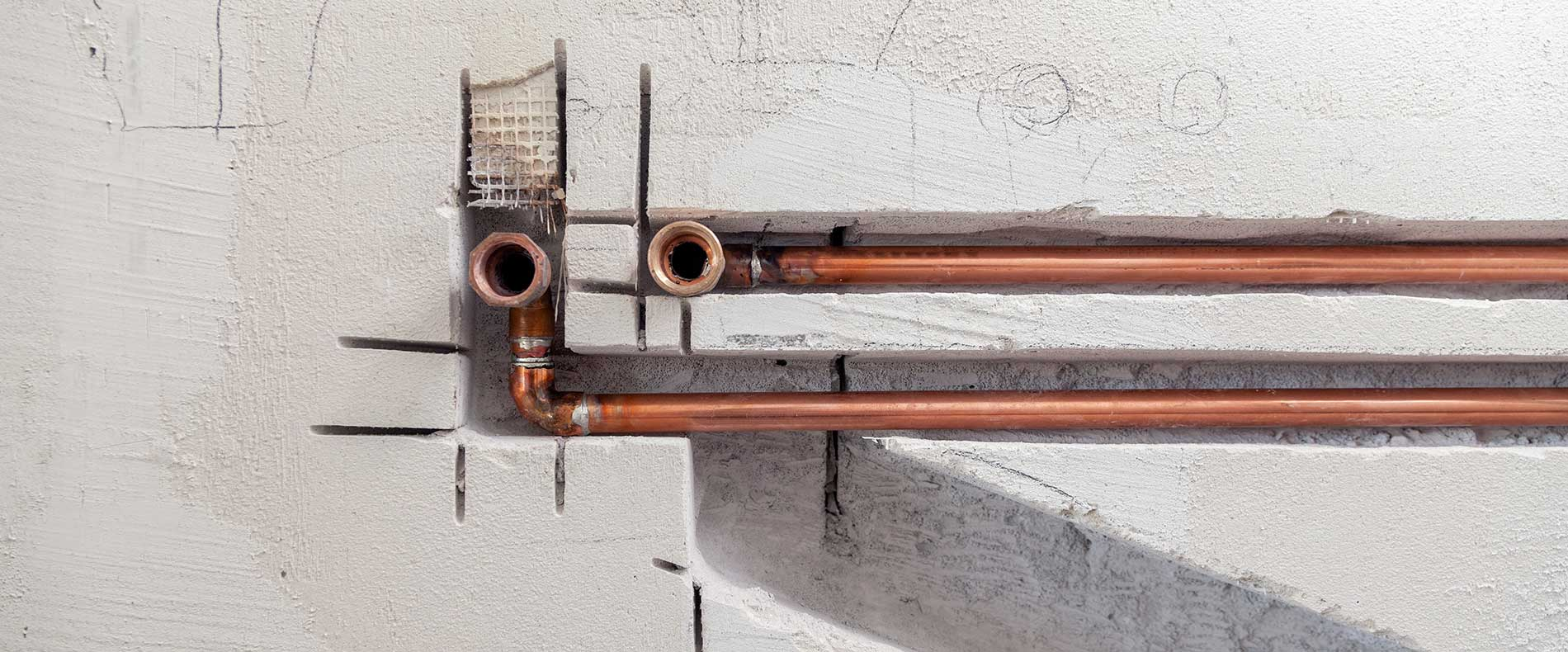 copper-pipes-in-foundation-of-walls